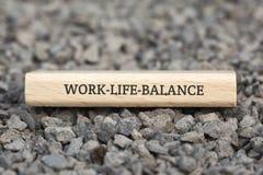 WORK-LIFE-BALANCE -与词的图象与题目工作生活平衡,词云彩,立方体,信件,图象,例证相关 免版税库存照片