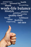 Work-life balance. Trying to find a good balance between work and life Stock Image
