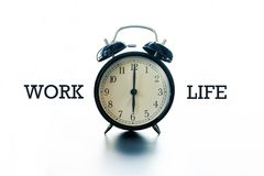 Work life balance concept, alarm clock with word Work and Life Royalty Free Stock Photography