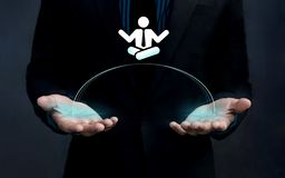 Work Life Balance Concept, Businessman Handle a shape of Man wit. H Yoga meditation posture stock photos