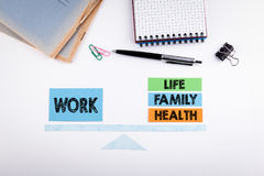 Work Life Balance concept. Paper scale on a white table Royalty Free Stock Images