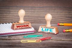 Work Life Balance concept. Rubber Stamp on desk in the Office Stock Images