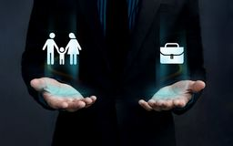 Work Life Balance Concept, Shape of Family and Work Briefcase Fl. Oat over Careful Gesture Hand Stock Photo