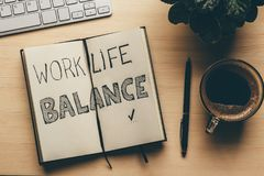 Work Life Balance - handwrite words in open notebook, pen, cup of coffee, top view. Lifestyle success strategy concept Royalty Free Stock Images