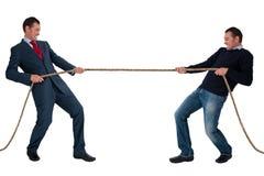 Work life balance. Man tug of war isolated on white background Stock Photos