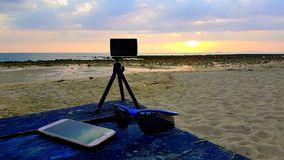Work Life Balance and Relax in your Homeoffice everywhere on the World. A workplace on the beachfront of the Andaman ocean in beautiful sundown royalty free stock photography