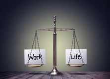 Work life balance scales. Business and family lifestyle choice royalty free stock image