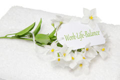 Work-Life-Balance spa decoration with white jasmine and a sign Royalty Free Stock Photo