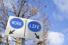 Work or Life Choice. Road sign with WORK and LIFE Royalty Free Stock Photography