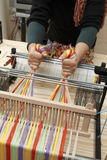 Work on loom. A woman weaving on the loom royalty free stock photo