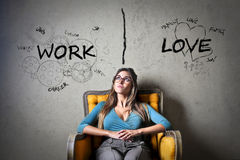Work or love. Woman deciding between work and love Royalty Free Stock Image