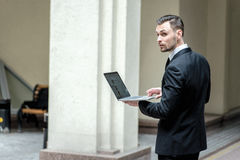 Work at lunch. Successful businessman standing in the street hol Royalty Free Stock Image