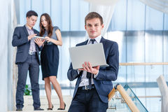 Work at lunch . Young and successful businessman standing on the Stock Image