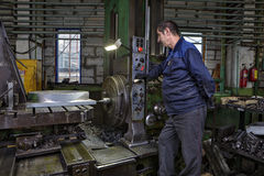 Work machine tool operator controls process of drilling steel pa Royalty Free Stock Images