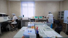 Work in a medical laboratory. In the frame, two nurses or doctors, they are engaged in the analysis of samples obtained. From patients. The accuracy of the stock video footage