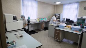 Work in a medical laboratory. In the frame, two nurses or doctors, they are engaged in the analysis of samples obtained. From patients. The accuracy of the stock footage