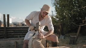 Work of the medieval carpenter with hand tools and wood stock footage