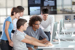 Work meeting. Group of young adults in business training Royalty Free Stock Images