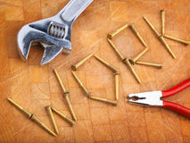 Work metaphor. Written in screws with tools, focus on W Stock Photo