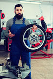 Work motorcycle repair shows the repaired tire. On a scooter Stock Photo