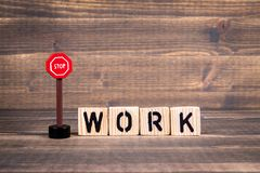 Work Name from wooden letters with road sign. On wooden background royalty free stock photography