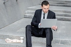 Work is not in place. Successful businessman working on a comput Stock Photos