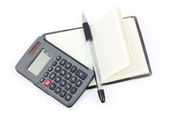 Work. Notebook, calculator and pen on a white background. Office working set stock photos