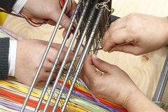 Work ob loom. Two persons working on loom royalty free stock photo