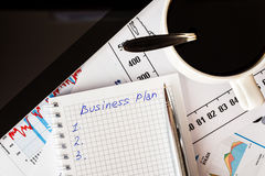 Work in the office, coffee cup with business plan Stock Photography