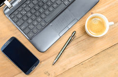 Work office desk with computer keyboard, mobile phone, pen and cup of coffee. Stock Photo