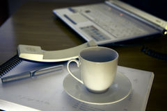 Work office desk with a cup of coffee computer laptop Stock Images