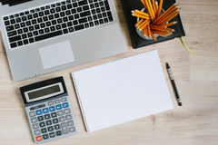 Work office desk table with laptop, tablet, supplies and calculator. Top view with copy space. Flat lay finance background royalty free stock photography