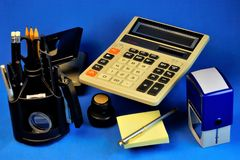 Accounting office Desk background blue, with the necessary accessories for the job. stock photography