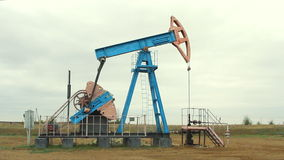 Work of oil pump jack on a oil field stock video footage