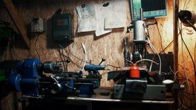 Work old lathe machine. Work old lathe machine in garage stock footage