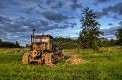 After work. Old veteran Bulldozer parked in a meadow after work Royalty Free Stock Images