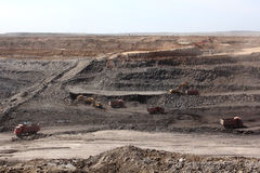 Work on the open pit. Trucks carry ore open pit Stock Photography