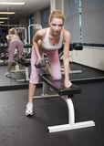 Work Out. A lovely young blonde woman working out stock photos