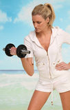 Work out at the beach. Beautiful blond woman doing work out at the beach Stock Photo