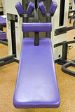 Work Out Bench. A purple workout bench in a gym royalty free stock photo
