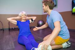 Work out fitness old woman doing sit ups abs abdominal royalty free stock photography