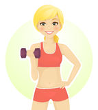 Work out. Sport girl working out with dumbbells Royalty Free Stock Photography