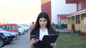 Work outdoor by pretty girl stock footage