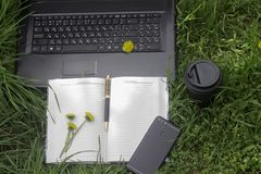 Work outdoors with telephone ,laptop and coffe stock images