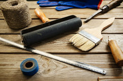 Work and painting tools on the wooden background. horizontal Stock Photography