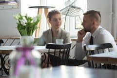 Work partners talking during break Stock Image