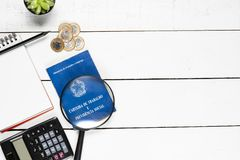 Work permit, cactus, notepad, black pencil, glasses, calculator. Glasses and some Brazilian one real coins on white background pinus royalty free stock photography