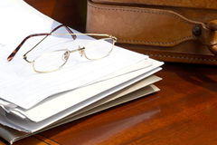 Work pile into briefcase Royalty Free Stock Photo