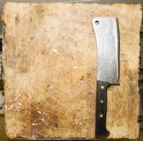 WORK PLACE OF BUTCHER. HATCHET ON TABLE. BUTCHER TOOLS, KNIFE, SAW, HATCHET. WORKTABLE BY BUTCHER. BEEF AND PORK SLICE stock photos