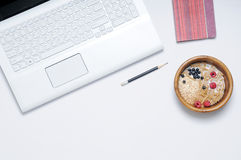 Work place with cereal and milk for breakfast Stock Photo
